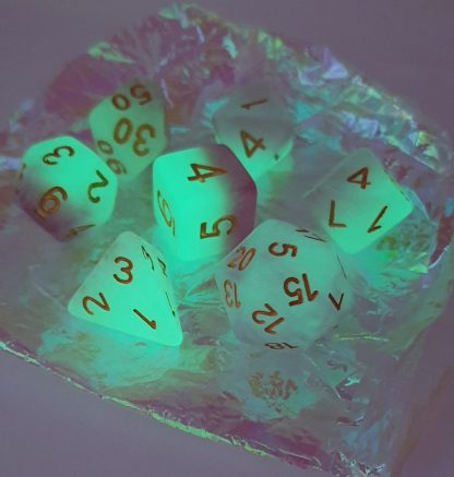 Glow in the dark pink and white polyhedral dungeons and dragons dice set