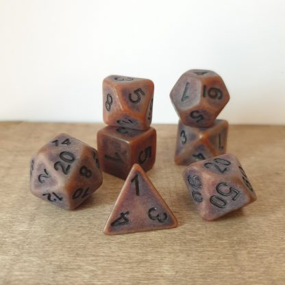 Artificer worn bronze effect polyhedral dungeons and dragons dice set
